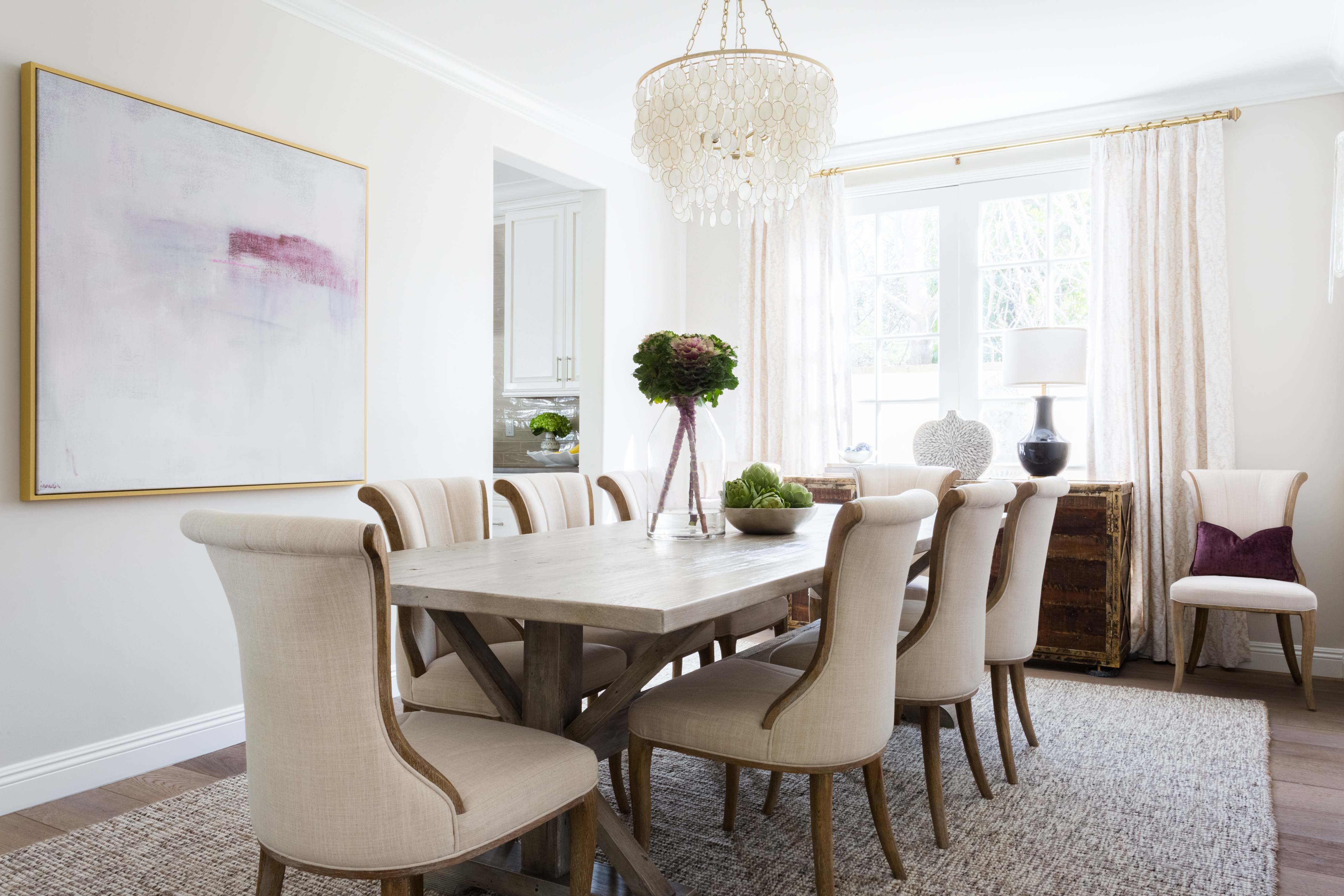 A dining room with a table and chairs  Description automatically generated with low confidence
